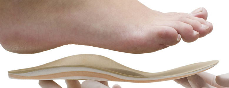 Someone being fitted for custom-made orthotics near Bayswater